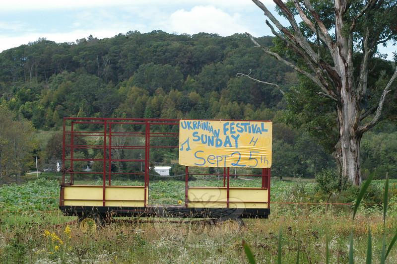 A hay trailer positioned near Sugar Street (Route 302) advertises the Ukrainian Festival.  (Gorosko photo)