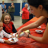 Alexa Vacaro, right, added the final topping to Madison McCulloch, right, and Amber McCulloch's ice cream sundaes during Hawley Elementary School's annual Ice Cream Social on Thursday, September 22. During the event Hawley students and families gathered in the school's gymnasium to assemble ice cream sundaes before heading outside to the school's playground.  (Hallabeck photo)