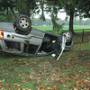 The driver of a Jeep SUV traveling on Wasserman Way, near its intersection with Mile Hill Road South, apparently lost control of the vehicle during wet conditions at about 5:10 pm on Wednesday, September 28, resulting in the Jeep leaving the roadway and rolling over onto its roof. Police, ambulance, and fire personnel were called to the scene of the accident. Newtown Hook & Ladder and Sandy Hook firefighters were alerted. Police did not have details on the incident before deadline on Thursday.  (R. Scudder Smith photo)