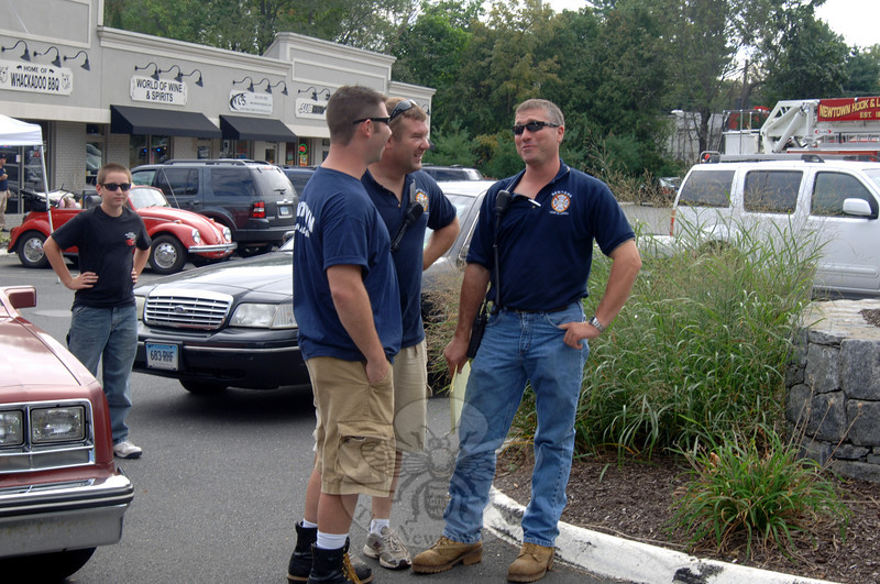 Firehouse Ride & Pig Roast Chairman Tim Hoeffel, left, talks with fellow Hook & Ladder members Brian Slattery and Rob Manna minutes before the ride begins.  (Bobowick photo)