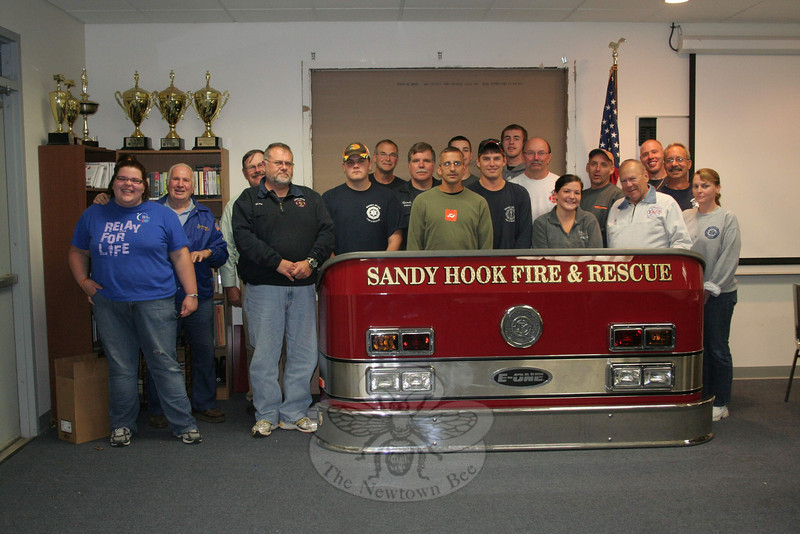 Sandy Hook Volunteer Fire & Rescue Co. will host an open house on Sunday, October 2. The public is invited to visit the company's main station, at 18-20 Riverside Road, between 11 am and 2 pm. Members will be offering fire prevention tips, leading tours of and answering questions about the apparatus, and running demonstrations of motor vehicle extrication. Newtown Police Department will be running seat belt safety demonstrations, and Smokey The Bear will be visiting. All are welcome. Call the station at 203-270-4392 for additional information.  (Hicks photo)