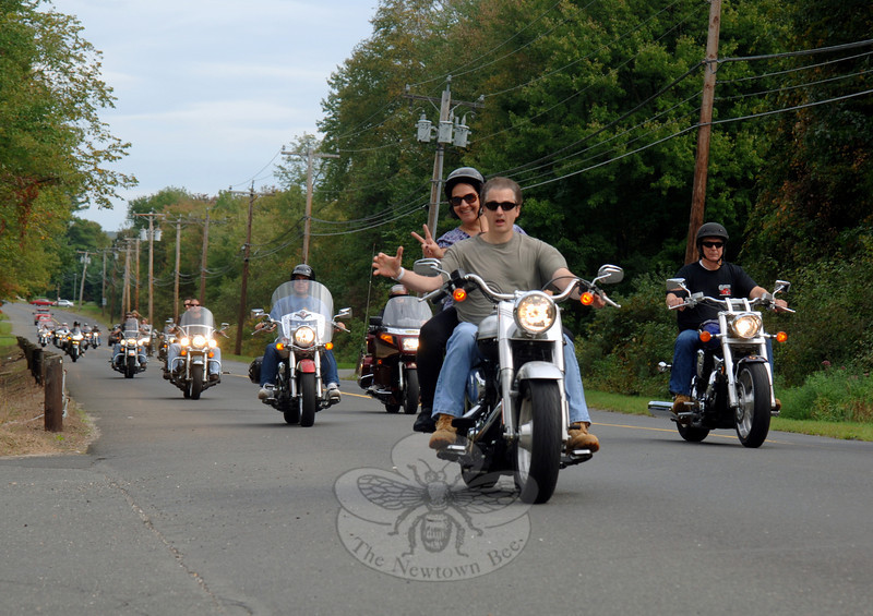 Mark and Betsy Streck ride midpack through Southbury.  (Bobowick photo)