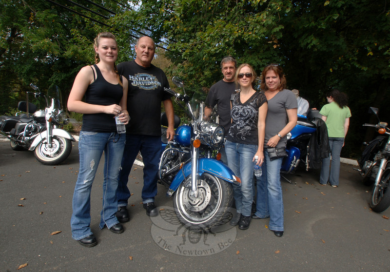 From left are Melissa Yitts and her father Lou standing near his Harley, with JoAnn Maude between Nancy and Chris Portolese.  (Bobowick photo)