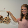 """Newtown High School student Nicole DeFelice created """"Stop Whining: Get Yourself Tested"""" using a collection of wine bottle corks. She is one of six NHS students who have shared their talents to create artfully decorated brassieres for this weekend's """"2x2: Artful Bras & Boxers"""" events. A formal cabaret evening will be hosted by Newtown United LLC on Saturday in Edmond Town Hall's Alexandria Room, and a fall marketplace will then run on Sunday afternoon in the same location.  (Hicks photo)"""