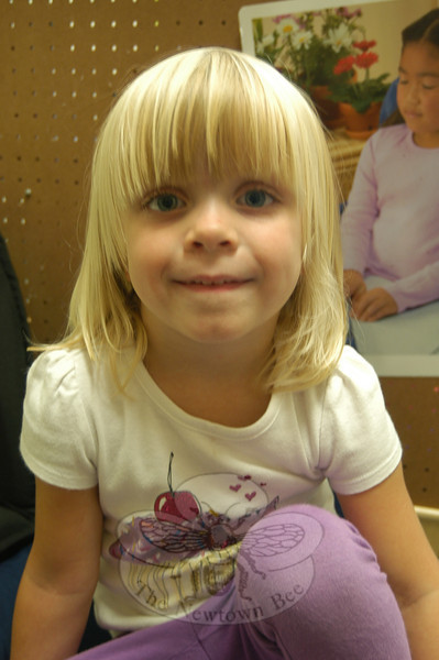 Newtown Bee: What makes you happy? Erin Barrett: Mom and dad, because I love them.  (Hallabeck photo)
