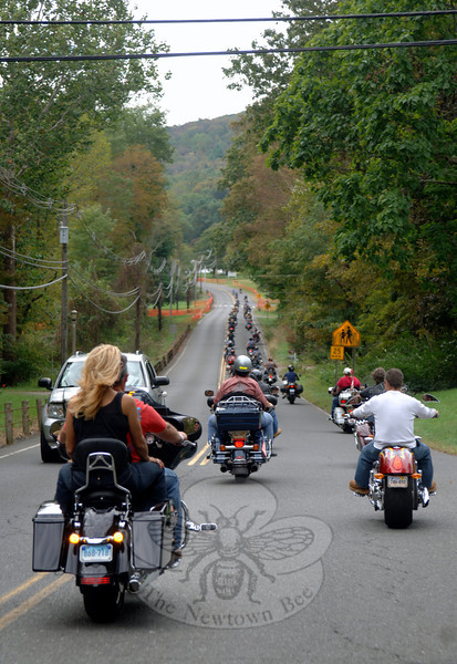 A cluster of motorcycle riders wound its way along scenic roads Sunday, September 25.  (Bobowick photo)