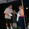 Mr Morning hands the microphone to Mary Teicholz, an LLS Honored Hero during the 2011 Light The Night Walk at Fairfield Hills on September 24.  (Hicks photo)