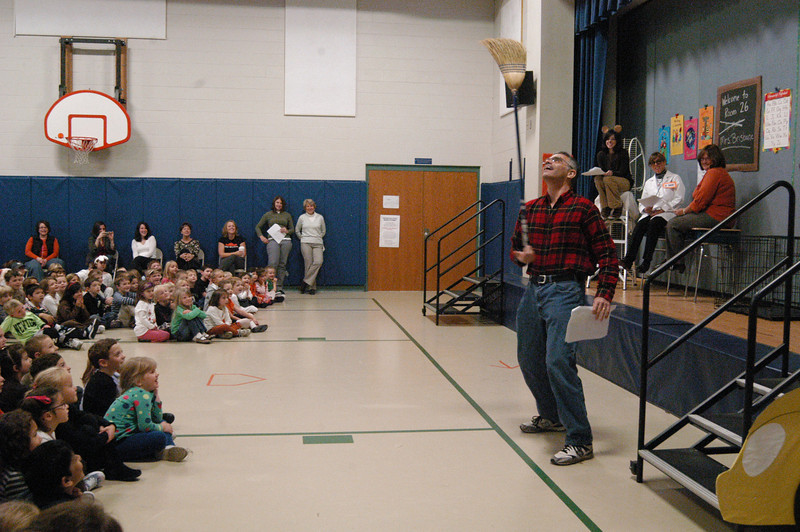 Hawley Elementary School Third grade teacher Sam Haber balances a broom in one hand while portraying a janitor during a skit on Friday, October 29, to celebrate the school's One School One Read book, Life According to Humphrey by Betty G. Birney.  (Hallabeck photo)