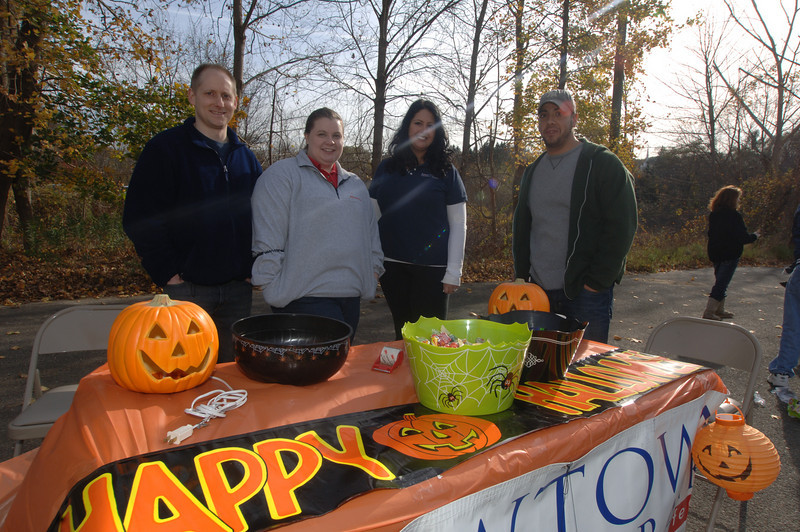 Welcoming guests and treating them to Halloween candy were Newtown Savings Bank staff John Radici, Cheryl Jablonowski, Amy Kerce and Marc Imbimbo.  (Bobowick photo)