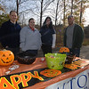 Welcoming guests and treating them to Halloween candy were Newtown Savings Bank staff John Radici, Cheryl Jablonowski, Amy Kerce and Marc Imbimbo.  (Bobowick photo)