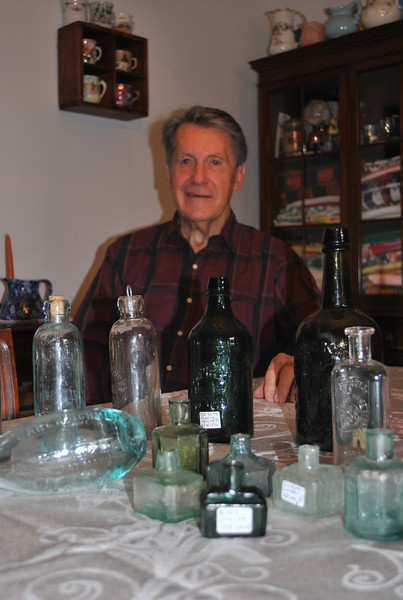Dick Baker has been collecting glass bottles since his youth, and is now promoting support for The Museum of Connecticut Glass in Coventry, on whose board he sits. The museum needs at least $3 million to complete renovations that will allow it to open to the public on a regular basis and provide educational programs.  (Crevier photo)