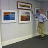 "An exhibition of photographs entitled ""When Fall Comes to New England: A Short Lived Gift to Behold"" will open at Cyrenius Booth Library in Newtown on Sunday, November 7. The work, by former Newtown resident Tom Kretsch, was inspired by the words and music from singer-songwriter Cheryl Wheeler's song of a similar title, which captures the moods and feelings of this season of change. With 36 images that were hung in the library's lower meeting room on November 2, Mr Kretsch has assembled an essay of images depicting the splendor of this glorious but short-lived magical time. Along the shoreline, deep in the woods, across the meadows and by the rivers he has captured this season's beauty: life's last gasps before winter's long cold sleep. ""Having grown up in Newtown and graduated from high school here, it is nice to have a chance to share my work in the library,"" said Mr Kretsch, who will host an opening reception for ""When Fall Comes To New England"" on Sunday, November 7, from 2 to 4 pm. The public is invited to meet the NHS graduate on Sunday, or to visit the exhibition during regular library hours during the next four weeks. The exhibit will remain on view until December 5. For more information call the library at 203-426-4533.  (Hicks photo)"