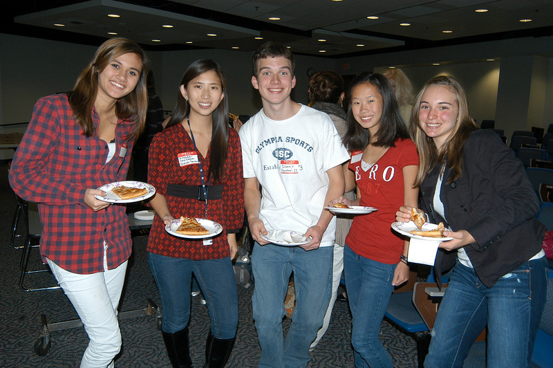 From left, Newtown High School junior Kate Bartel, English teacher and NHS Chinese 2011 Delegation student ambassadors overseer Amanda Friedman, junior Don Morrissey, sophomore Leah Pinckney, and junior Abbey Doski stand together in NHS's Lecture Hall during the first meet and greet for the delegation group scheduled to visit the high school's Chinese sister school in April.  (Hallabeck phto)