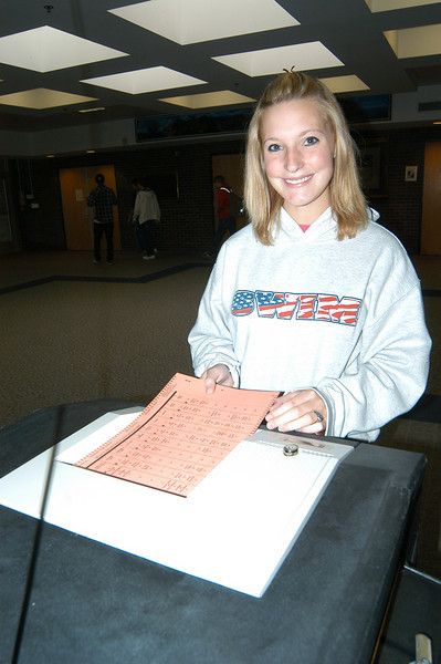 Newtown High School senior Kelsey Perez was one of more than 200 students at NHS who voted in the school's mock election on Friday, October 29, by 12:30 pm. Democratic Registrar of Voters LeReine Frampton said she hopes to make the mock election event annual at the school.  (Hallabeck photo)