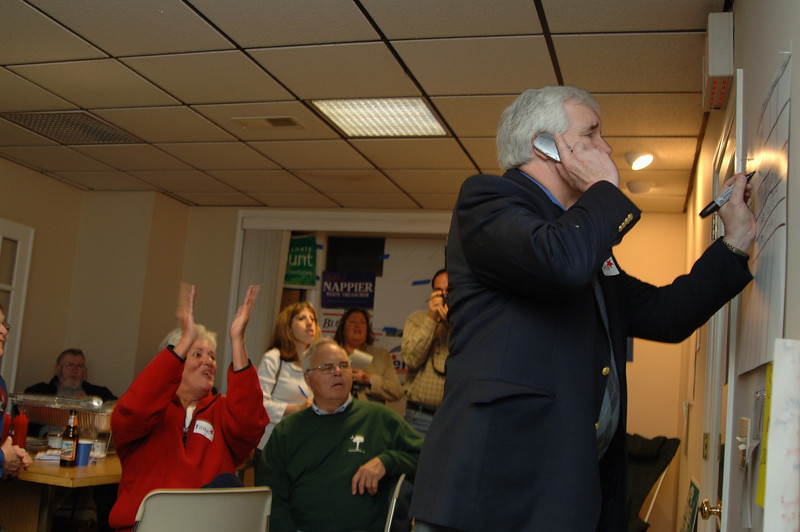 Former Democratic first selectman Herb Rosenthal listens as a caller gives him counts from the voting districts.  (Bobowick photo)
