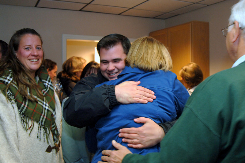 Supporters gathered at the Democratic headquarters Tuesday embrace Chris Lyddy, and celebrate his win.  (Bobowick photo)