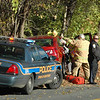 Sandy Hook Fire & Rescue volunteers and police assisted the elderly occupant of a vehicle that ran into a stand of trees about 10 am on November 2, near 3 Riverside Road.  (Voket photo)