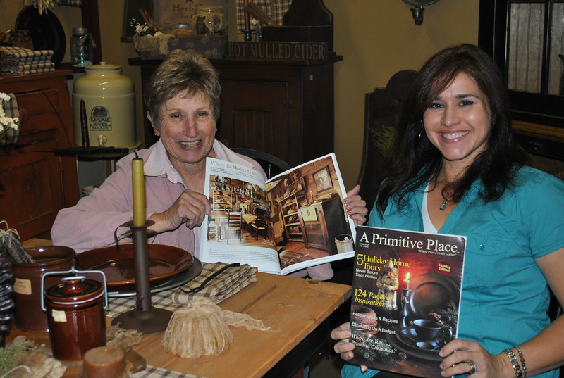 Linda Manna, left, owner of Newtown Country Mill on Route 302, and her daughter, Michelle Ferris, have their homes, as well as Ms Manna's business, featured in the Winter edition of the new quarterly magazine, A Primitive Place. Photographers from the publication will visit Saturday, November 20, from noon to 3 pm, to sign copies of the magazine, available in this area only at Newtown Country Mill, or by subscription.  (Crevier photo)