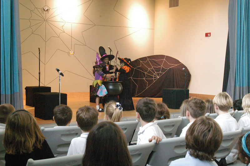 A spider sat down beside Miss Muffett just before the Three Witches of Shakespeare entered stage right at St Rose of Lima School on Thursday, October 28, for the school's production of Mother Goose Going on a Ghost Hunt. The Three Witches of Shakespeare, from left, Ashley Gotch, Ashley Silvaggi, and Madison Benson, stirred up a potion to help catch a pack of escaped ghosts. The play is part of a new theater program at the school, according to Princ-pal Mary Maloney, and was directed by Twyla Kessler.  (Hallabeck photo)