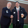 The two candidates for the 106th Assembly District seat, Republican George Ferguson, left, and Christopher Lyddy, ran into each other and greeted each other cordially outside the polls at Newtown Middle School Tuesday.  (Voket photo)