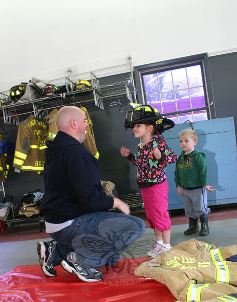 Penelope Jackson, with dad Brian and brother Wally, during the Sandy Hook Fire & Rescue open house.  (Hicks photo)