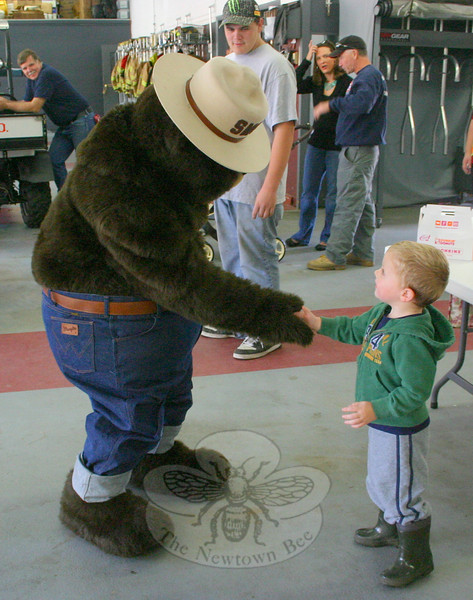 Wally Jackson made a new friend during the  Sandy Hook Fire & Rescue open house.  (Hicks photo)