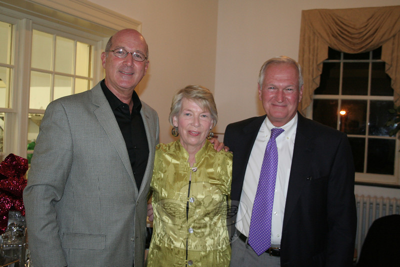 Dr Richard Coopersmith, who served as the evening's auctioner, with Kathy and Bob Geckle during 2 By 2.  Mitchell Girgasky was one of two servers who kept food flowing quickly from The Alexandria Room's kitchen out to the tables during 2 By 2: Artful Bras & Boxers.  (Hicks photo)