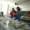 Newtown High School's Marching Band and Guard hosted its Third Annual 100-Family Tag Sale Saturday, September 17, in the cafeteria of Newtown High School. Besides the many items large and small donated by band and guard supporters, there were plenty of snacks and treats to satisfy the cravings of visitors including, from left, band parent Carla Kron, Ellery McFarland and his mom, Peggy.  (Voket photo)