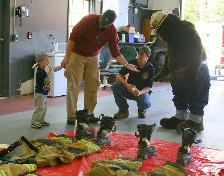 A tentative Nicholas Burke approached Smokey the Bear, with dad Michael initially offering a buffer between the toddler and the brown bear.  (Hicks photo)