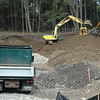 Earthmoving has started in preparation for construction at the 4.5-acre site for Edona Commons at 95 and 99 Church Hill Road in Sandy Hook Center. Dauti Construction, LLC, of Danbury gained approval to build the 26-unit townhouse-style condominium complex from the Planning and Zoning Commission (P&Z) in June. Eight of the condos will be designated as affordable housing. Town agencies had rejected the construction project, but the developer eventually gained construction approvals through court appeals filed under the state's Affordable Housing Land Use Appeals Act. The site is viewed from the south side of Church Hill Road. The Walnut Tree Village age-restricted condo complex lies in the area behind the trees in the background.  (Gorosko photo)