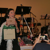 Paula Elfont during the live auction, with a gift certificate for Avance Esthetiques.  (Hicks photo)