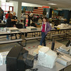 Cheryl Engels, in foreground, peruses the electronics table Saturday at Newtown High School during the band and guard's annual tag sale. The event was staffed and managed by the Newtown High School Band Parents Corporation.  (Voket photo)