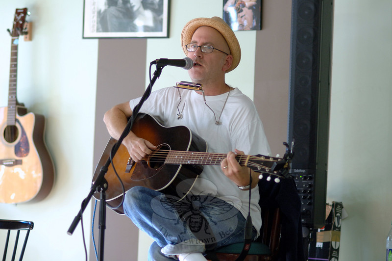 Writer and musician Chris Belden entertained a small crowd at The Hideaway Café on October 2 to benefit the publication of Sentences: A Book of Prose and Poetry Written by Inmates of the Garner Correctional Institution. The booklet is a compilation of inmates' writing following a workshop Mr Belden taught at Garner Correctional Institution.  (Bobowick photo)