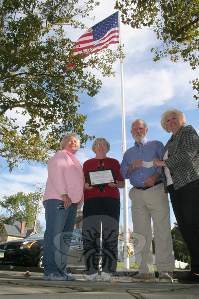 Newtown Woman's Club announced the winner of its This Place Matters competition this week: The historic Main Street flagpole. On Monday, October 3, project co-chairs Anna Wiedemann, on the left, and Jo Ann Bruno, on the right, were joined by Woman's Club President Gladys McLaughlin to present a check in the amount of $130 to Dan Cruson, who was representing Newtown Historical Society. Residents had been asked to consider a number of locations within town so that in September they could vote for their favorite. Votes were $1 each, and the flagpole was selected by voters as the most important location from a selection that had also included C.H. Booth Library, Edmond Town Hall, Fairfield Hills, The Matthew Curtiss House, The Newtown Bee, and Newtown Meeting House. Money raised through the friendly competition was donated to the historical society.	  (Hicks photo)