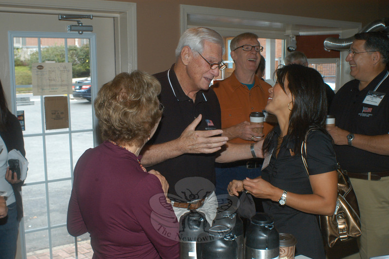 The candidates endorsed by the Independent Party of Newtown gathered at demitasse café in Sandy Hook October 1 to greet the public and talk politics over coffee and pastries. Here, IPN member Al Roznicki chats with selectman candidate Po Murray.  (Hutchison photo)