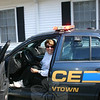 Nancy Belanger in a Newtown Police Department patrol car during the Sandy Hook Fire & Rescue open house.  (Hicks photo)