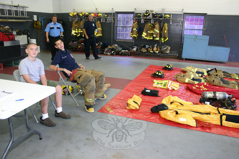 Patrick Doherty (left) and Andy DeWolfe covered the gear try-on station during the Sandy Hook Fire & Rescue Open House, October 2.  (Hicks photo)