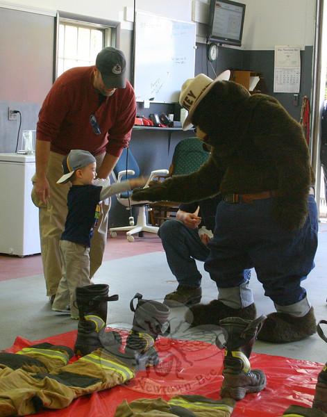 Nicholas Burke meeting Smokey the Bear.  (Hicks photo)