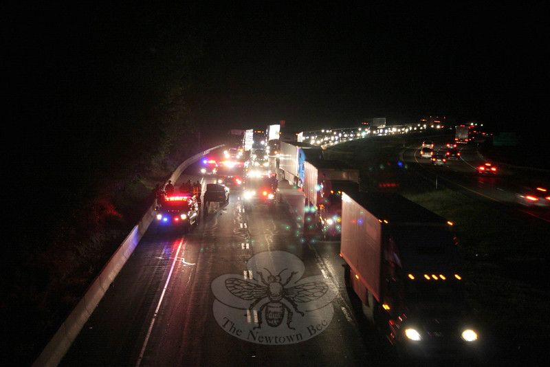 A two-vehicle accident on westbound Interstate 84 just east of the Parmalee Hill Road overpass at about 6:49 pm on September 27, caused travel delays on the highway. According to state police, Ronald Gaither, 37, of Bronx, N.Y., was driving a tractor-trailer truck in the right climbing lane of three lanes. Motorist Melanie Clark, 21, of Mt Kisco, N.Y., who was driving a 1999 Honda Accord, had been traveling behind the truck and then entered the center lane. The Honda then drifted to the right and struck the truck's trailer. State police added that Newtown Volunteer Ambulance Corps members transported Clark to Danbury Hospital for treatment of minor injuries. Newtown Hook & Ladder firefighters responded to the accident.  (Hicks photo)