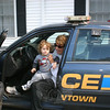 Nancy Belanger and her grandson Henri Quirk in a Newtown Police Department patrol car during the Sandy Hook Fire & Rescue open house.  (Hicks photo)