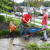 Mackenzie Voight, 3, usually spends much of her day with her mom, but on Wednesday, September 28, she was too interested in dad's work to leave him on his own. That's why passersby of the landscaped area on one corner of the Church Hill Road-Queen Street intersection may have done a double-take if they noticed a crew hard at work that afternoon. Mackenzie was right in the thick of it, helping dad Mike and uncle Chris Voight, employees of American Contracting, tackle some mulching duties.  (Hicks photo)