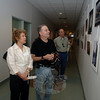 Micheline and Martin Williams view photographs on display this month at the municipal center. Her images are among those decorating the main hall of Newtown Municipal Center through October 27.  (Bobowick photo)