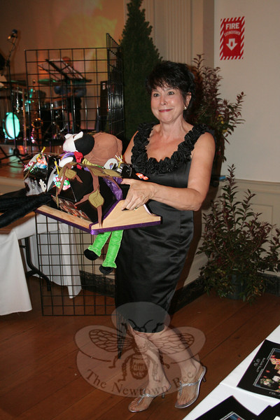 "Beth Caldwell, showing Rosemary Rau's ""Halloween Boo Boxes.""  (Hicks photo)"