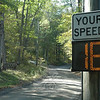 The Newtown Police Department has posted electronic speed displays on Point O' Rocks Road, a narrow dirt road that links Deep Brook Road to Boggs Hill Road. Point O' Rocks Road is now in use as a detour for traffic that normally would travel on the northern end of Boggs Hill Road. Northernmost Boggs Hill Road currently is closed to through-traffic for the replacement of culverts that carry a stream beneath that street.  (Gorosko photo)