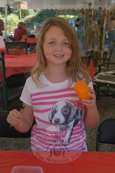 Sydney Leppones painted a pumpkin on Sunday, October 9, during one of the many activities offered at the Family Fun Farm Festival held at Sticks and Stones Farm, 201 Hunting-town Road.  (Hallabeck photo)