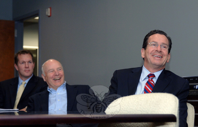 Governor Dannel Mallow shares a light moment during a presentation at the AFS building in Newtown. Behind him is company Chairman and Chief Executive Officer William Joyce, and in the background is Rob Powell, treasurer and operating partner.  (Bobowick photo)