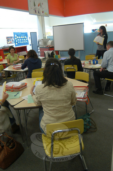 Kate Rossi, with the nonprofit organization Junior Achievement, oversaw an orientation for parent volunteers with the program at Head O' Meadow on Wednesday, October 5, in the school's library.  (Hallabeck photo)