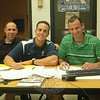 From left, Newtown Middle School physical education teachers Joe LaRosa, Matt Memoli, and Kenneth Kantor worked together Friday, October 7, during the school district's first early release day for professional learning communities.  (Hallabeck photo)