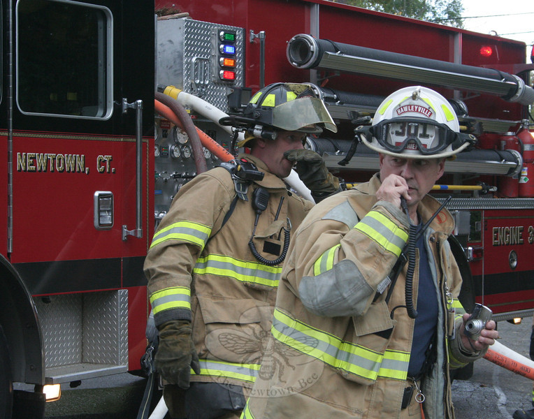 Hawleyville Fire Chief Joe Farrell, on the right, served as the officer in command of Sun-day's house fire.  (Hicks photo)