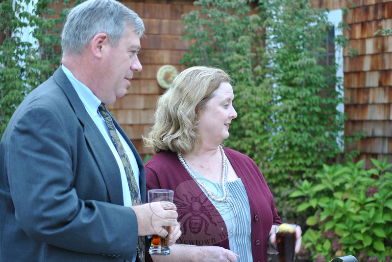 Newtown selectman Will Rodgers and his wife, Moira, are caught enjoying local beverages at the Farm to Table reception.  (Crevier photo)